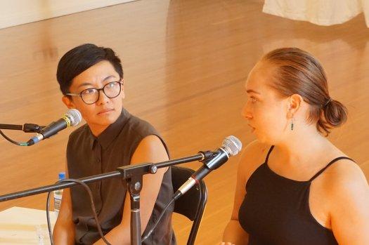 Jinghua listening as Isabella speaks